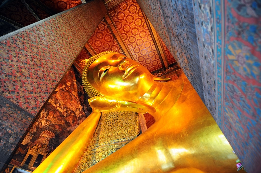 Reclining Buddha gold statue face. Wat Pho -Two days in Bangkok